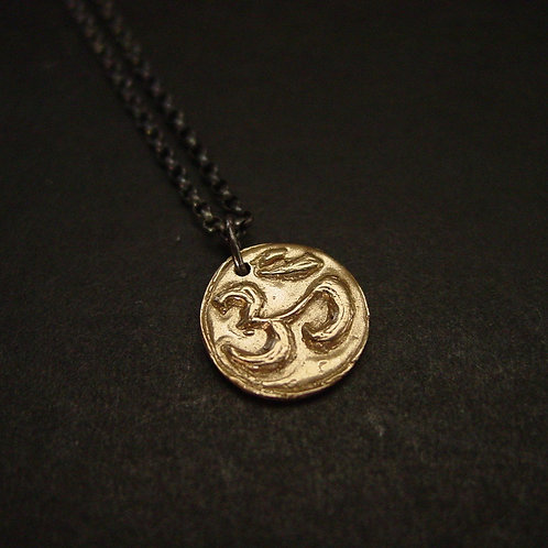 Om bronze with black chain necklace