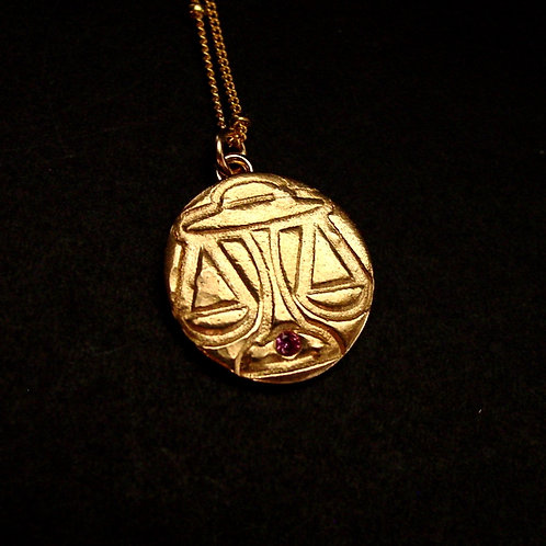 Libra with stone necklace close up