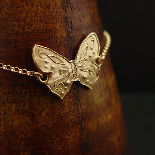 Small butterfly bracelet on display