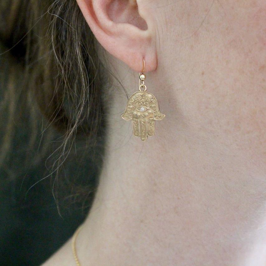 Hamsa Earrings on model