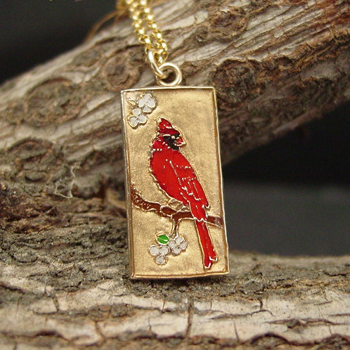 Small red cardinal necklace on branch