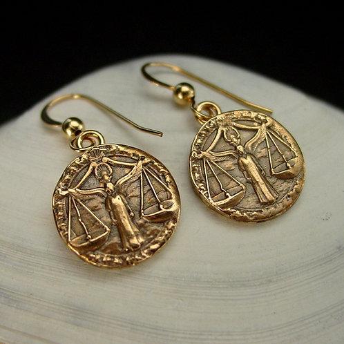 Libra earrings on shell