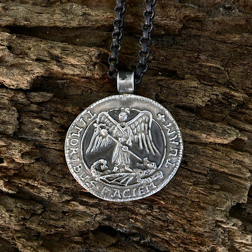 St Michael necklace outside