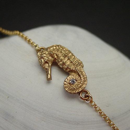 Seahorse bracelet on shell