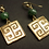 Greek key earrings with emerald