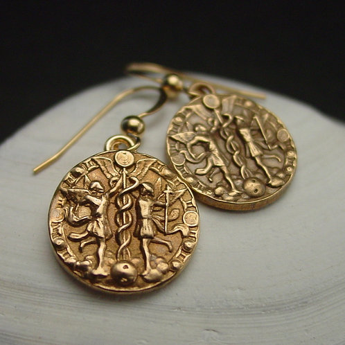 Gemini coin earrings on shell