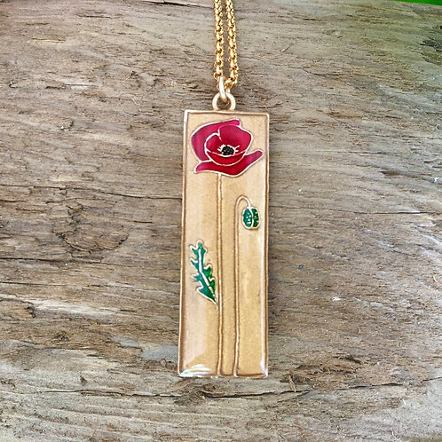 Single red poppy necklace outside