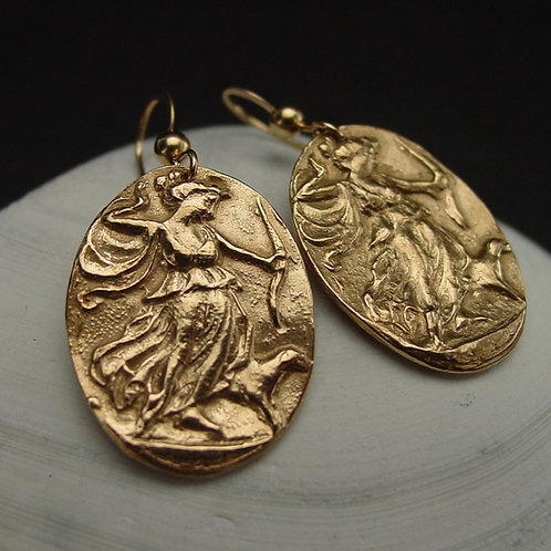 Artemis cameo earrings close up on shell
