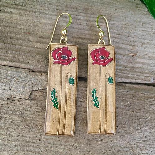 Single red poppy flower earrings outside