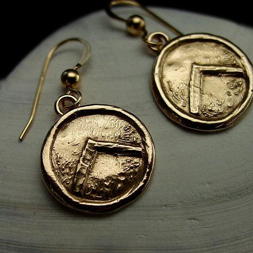 Spartan shield earrings on shell