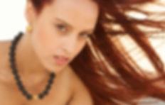Vis a Vis Jewelry model wearing dragonfly earrings
