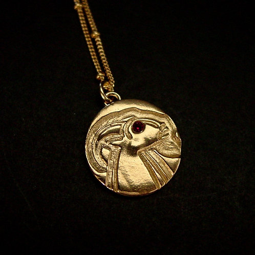 Capricorn with stone necklace close up