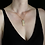 Blue lotus necklace on woman