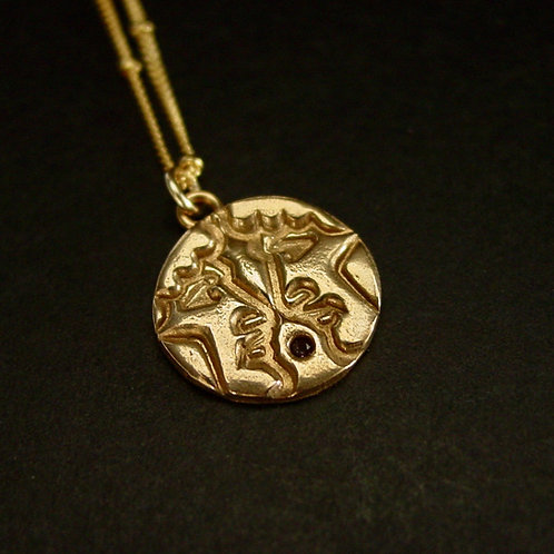 Gemini with stone necklace close up