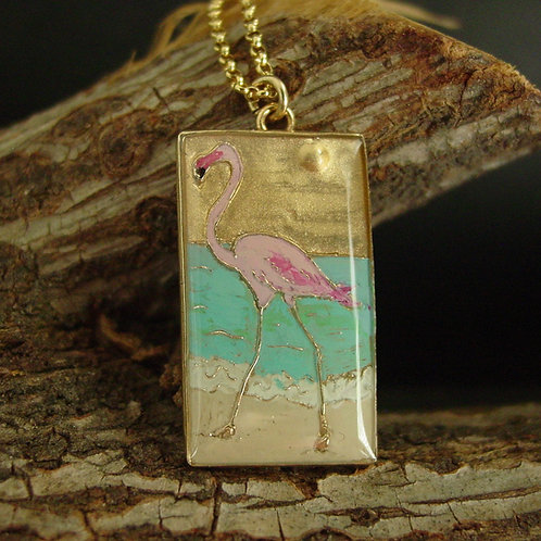 Flamingo necklace on branch close up