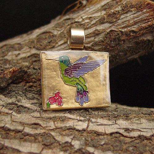 Hummingbird pendant on branch