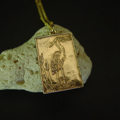 Heron necklace on coral