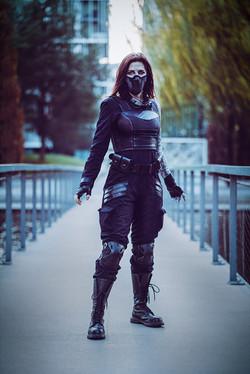 Tsuya as Bucky Barnes aka Winter Soldier wearing a black tacsuit.