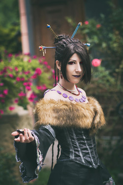 Lulu from Final Fantasy X posing infront of a lovely rose garden, Cosplay Costume by Tsuya