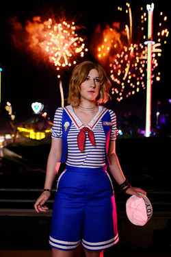 Robin Buckley from Stranger Things standing infront of fireworks