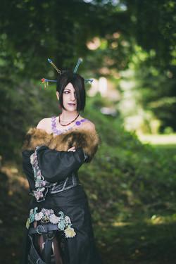 Lulu from Final Fantasy X standing in a garden.