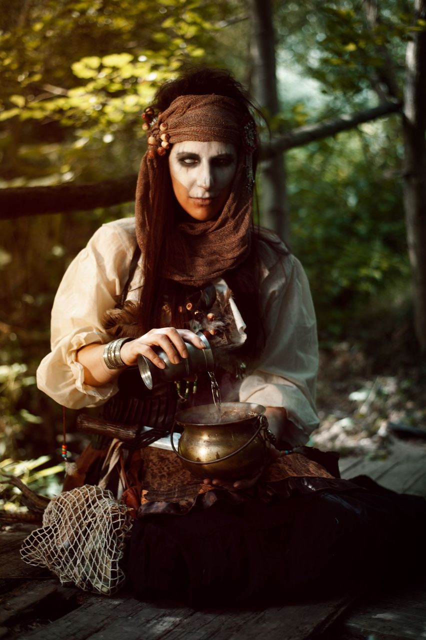Voodoo Vibes, Witch preparing potions in the woods. Halloween Costume by Tsuya