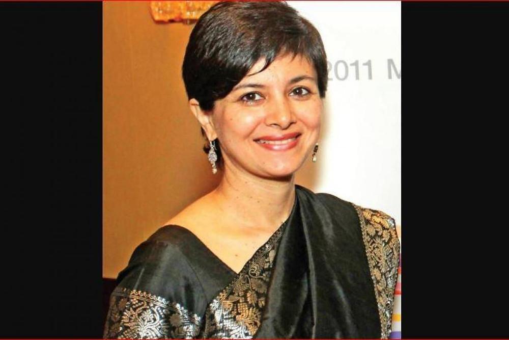 Jahnavi Barua wearing a black saree, smiling