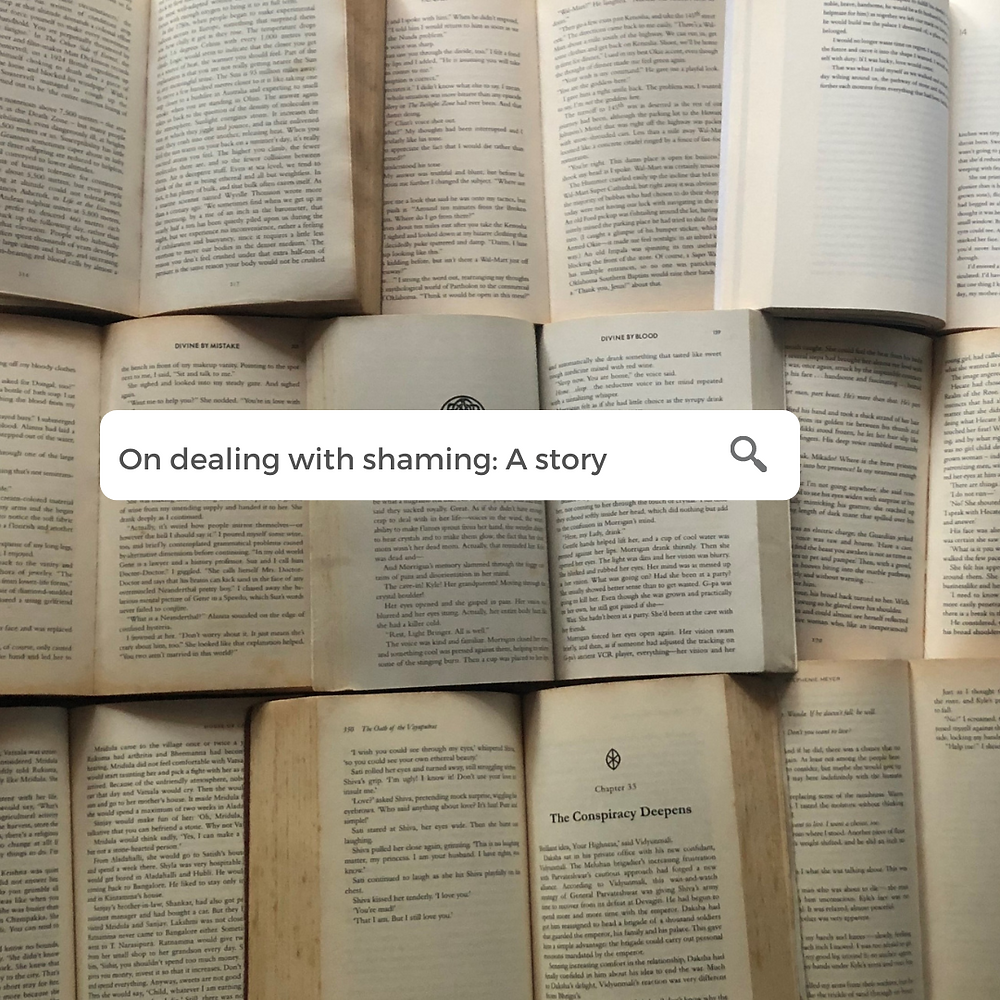 """In the background, open books arranged nearly across the picture. On top of this is a google search bar with text that says: """"On dealing with shaming"""""""