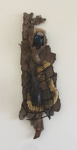 Caged Lady with Long Tail assemblage on bark using beach found objects 21x7