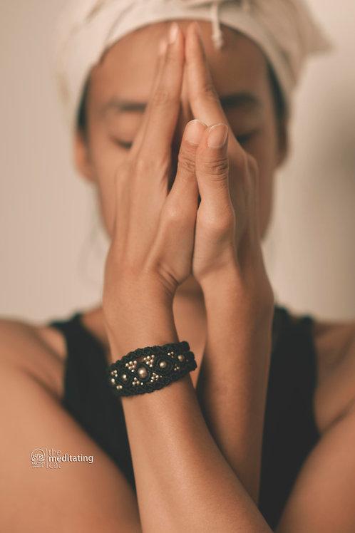 Macrame bracelet with many brass beads in black