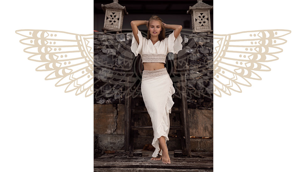 Beautiful girl wearing Lanna set of wrap around skirt and top made of natural fbric in light beige color