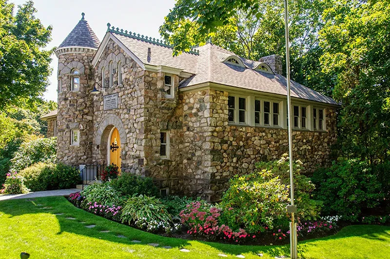 Stone library in Ogunquit, Maine, surrounded by greenery
