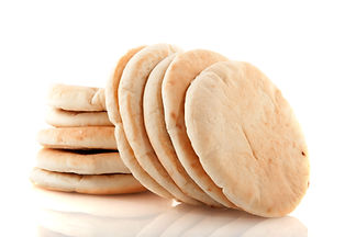 Pita flat bread stacked and isolated ove
