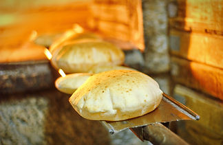 Pita bread in oven.jpg