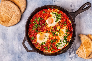 Shakshuka in a Frying Pan. Eggs Poached