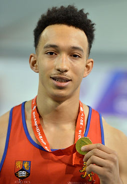 Image of former University of Birmingham scholarship athlete Lawrence Davis with his gold medal from BUCS indoors triple jump