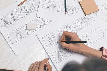 hands-draw-storyboard-film_8119-2582.jpe