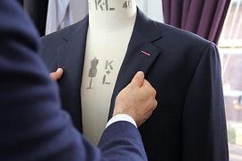 Carl - holding suit - workroom (1).JPG