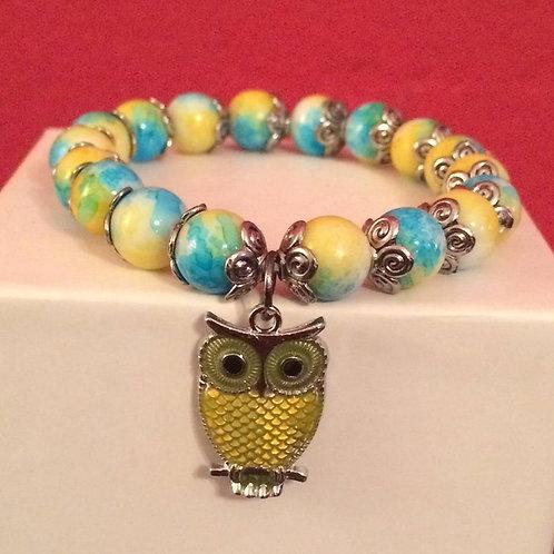 blue and yellow stretch owl bracelet