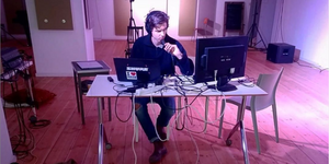 "Composer and Organizer Hidde Kramer sitting in the main ""control centre"" space in Studio LOOS - testing broadcasting mainframe"