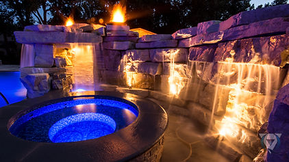 Hot Tub with stone wall and fire features