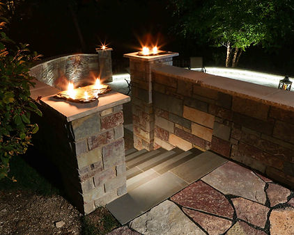 Outdoor stone staircase with fire features