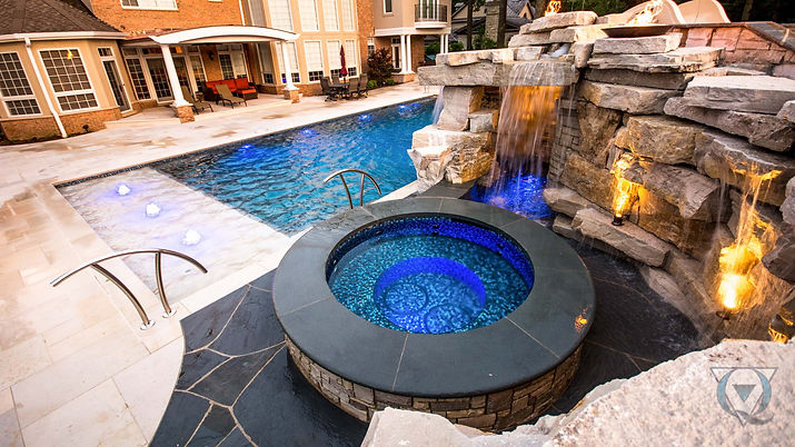 Jacuzzi and pool with rock waterfall