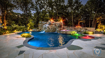 Inground pool with stone waterfall, hot tub, and fire features