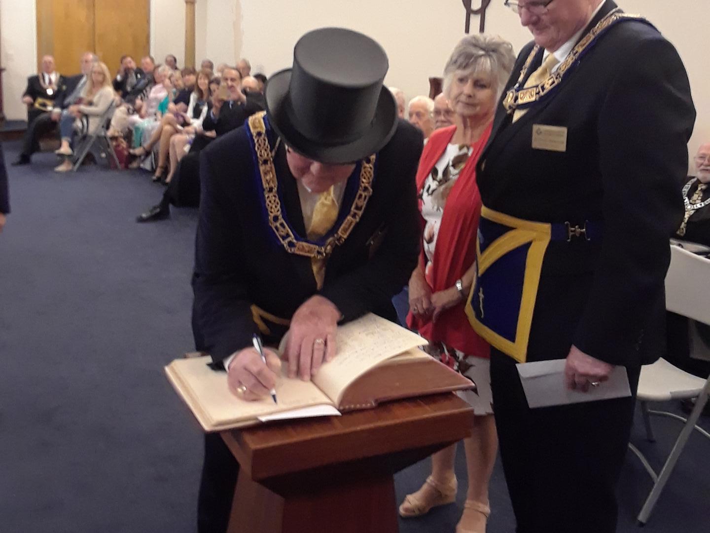 Grand Master Signing Sullivan Bible.png