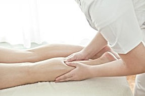 someone getting their legs massaged