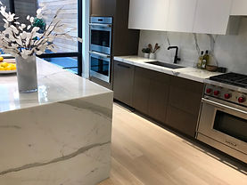 Calacatta Marble Island with waterfall side panels