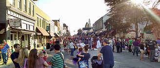 A Big Crowd won festival day on Salem Street in front of the shop.