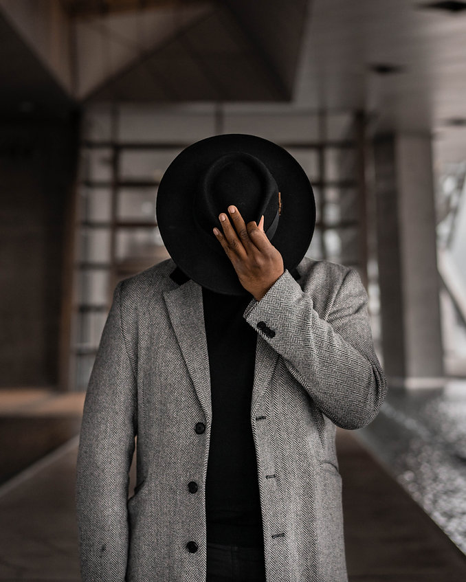 person-in-gray-coat-holding-black-hat-36