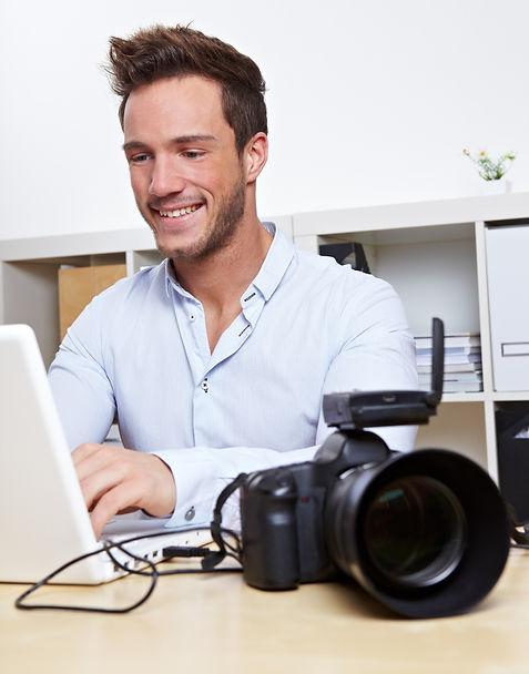 Photgrapher at computer_edited.jpg
